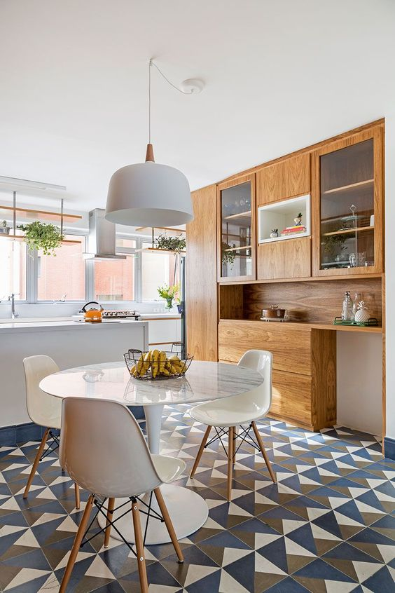 open kitchen, patterned floor tiles, white tulip table, white modern chairs, white pendant, white kitchen table, wooden built in cupboard