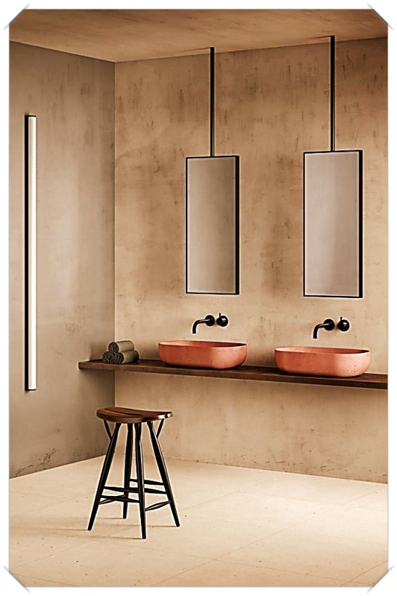 pink brown seamless wall, wooden floating vanity, pink round sink, black faucet, hanging from the ceiling mirror, stool