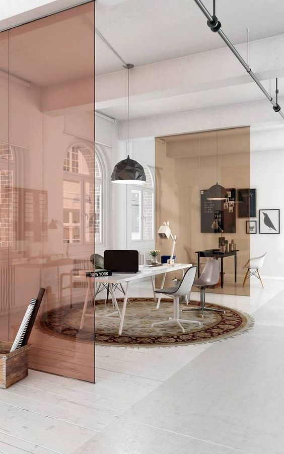 pink glass divider, white wooden floor, white ceiling, white wall, black pendant, white table, black chairs