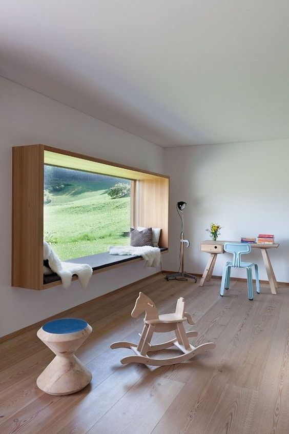 playroom, wooden floor, wooden toy, wooden study table, blue chair, large glass windows with box window nook