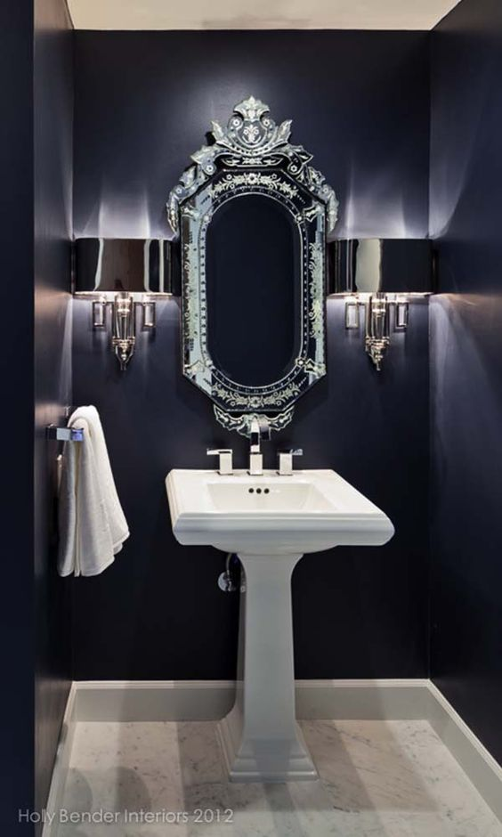 powder room, navy wall, white marble floor, white sink, silver sconce, silver framed mirror