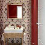 Powder Room, Red Wall, Patterned Wall Tiles, Rattan Vanity, White Sink, Mirror