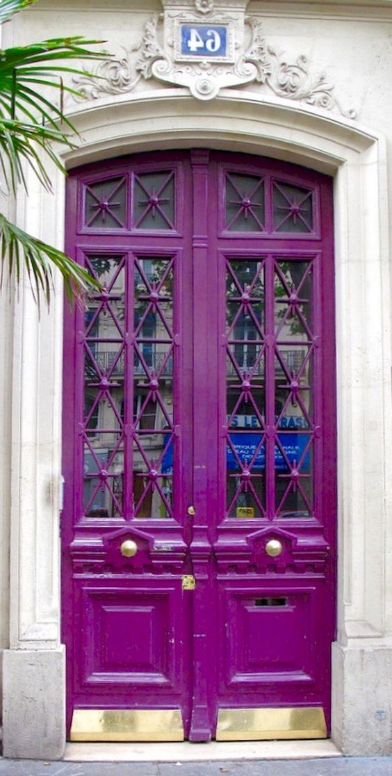 purple painted door, glass details, golden bottom, white wall