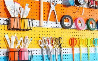 rainbow pegboard with hooks and small boxes