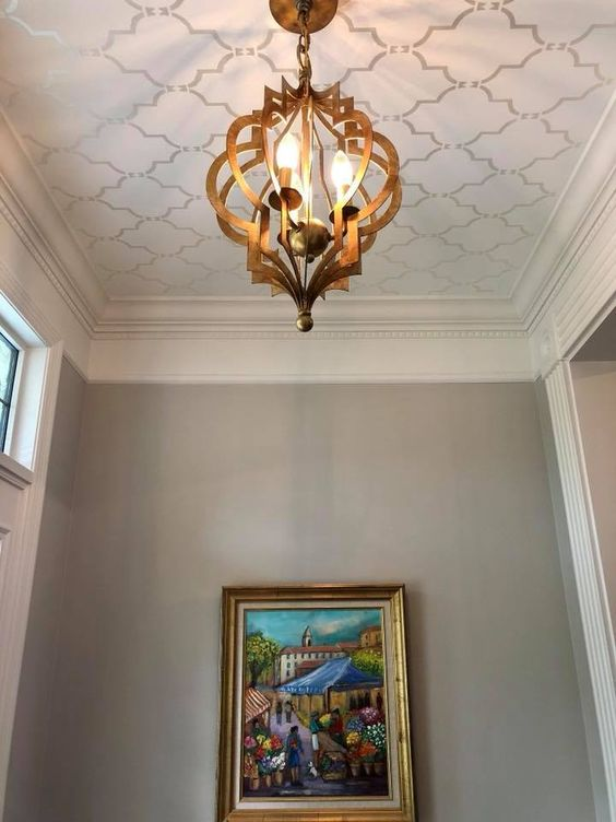 simple stencil patterned ceiling, exotic pendant, grey wall, painting
