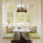 Small Banquette, Woden Floor, White Bench, White Wainscoting, Green Cushion, White Wall, Wooden Shelves Above The Nook