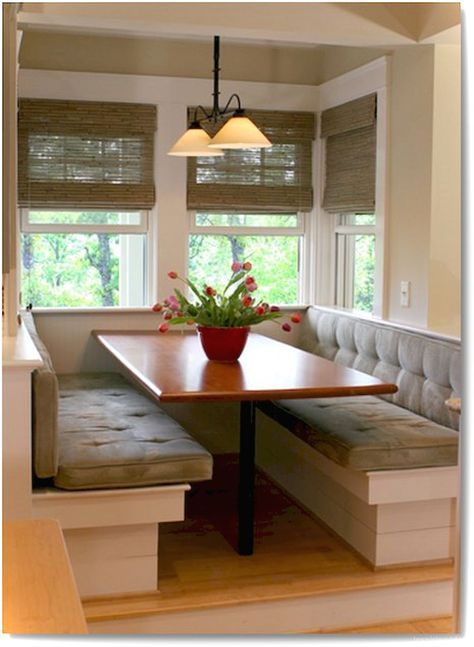 small banquette, wooden floor, white wooden bench with grey velvet cushion, white wall, white pednant, wooden table
