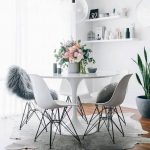 Small Dining Room, White Tulip Able, White Midcentury Modern Chairs, Grey Rug, Wooden Floor, White Floating Shelves, Clear Glass Pendant