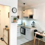 Small Kitchen, White Floor, White Bottom Cornered Cabinet, White Cornered Upper Cabinet, Wired Pendant, Wooden Floor, White Dining Table, Black Chairs