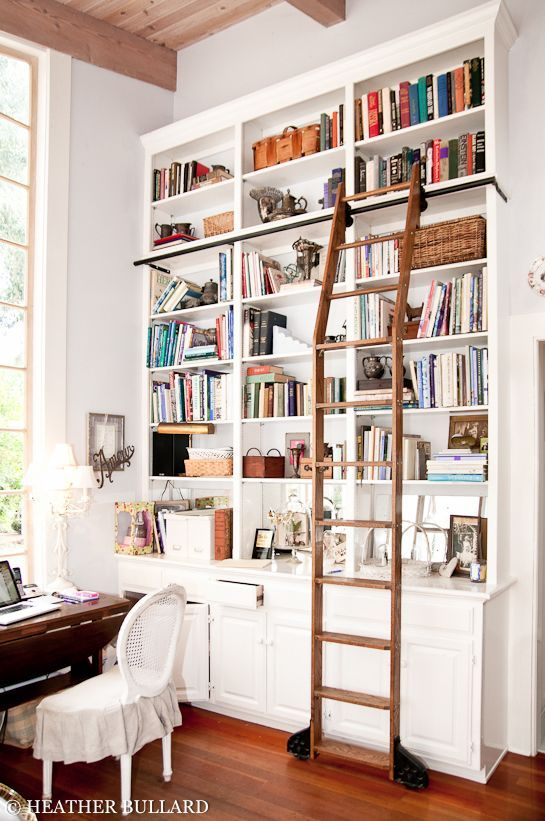 study room, wooden floor, wooden table, white chair, white wooden shelves with brown staurs