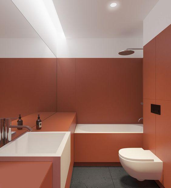 terracotta seamless bathroom, with white tub inside, white apron sink, white floating toilet, mirror, white ceiling