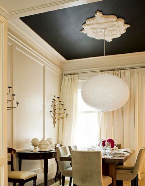 tray ceiling with black painted area, white tray for the pendant, white wall, dining set under, white pendant