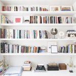 White Bookshelves With Longer Part At The Bottom, Wooden Floor, Rug
