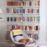 White Floating Bookshelves, Wooden Floor, White Chair, White Ottoman