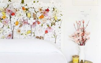 white flowery headboard, white beding, white wall, golden side stool