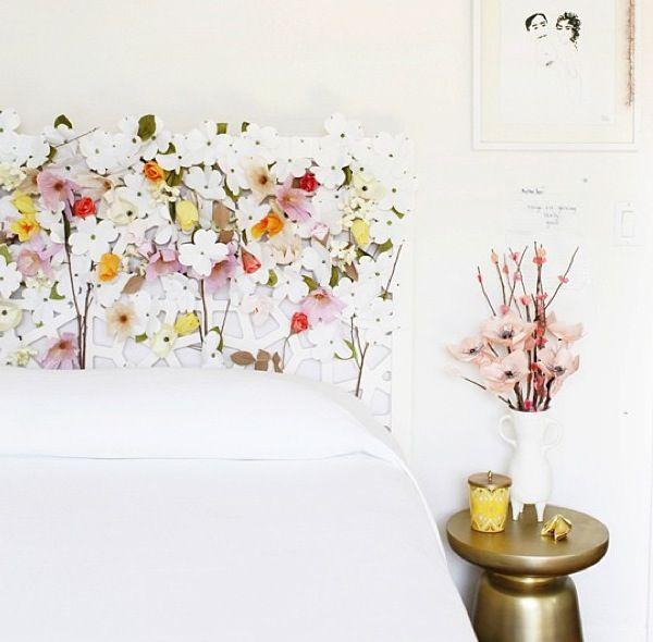 white flowery headboard, white beding, white wall, golden side stool