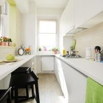 White Galley Kitchen, Wooden Floor, White Smooth Cabinet, White Subway Tiles, Black Stools, Side Island