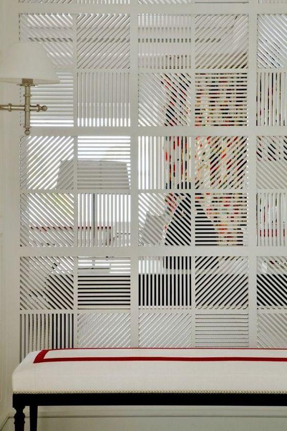 white klatt room divide with different patterm white bench, white sconce