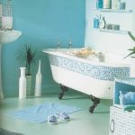 White Tub With Blue Mosaic Tiles On The Rim, Black Claw Foot, Blue Floor And Wall, Floating Shelves, White Sink