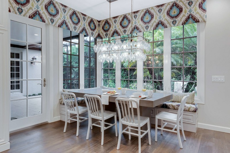 window valance crystal chandelier concrete table white chair window seat wooden floor glass windows glass doors patterned valances