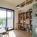 Wooden Book Shelves, Wooden Floor, Wooden Study Table, Chairs, Table Lamp, Sliding Door, Stool