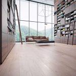 Wooden Built In Shelves, Wooden Floor, Pendants, Leather Sofa, Black Bench
