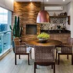 Wooden Chair With Rattan Back, Wooden Floor, Wooden Round Table, Wooden Accent Wall, Wooden Bottom Cabinet, Patterned Backsplash