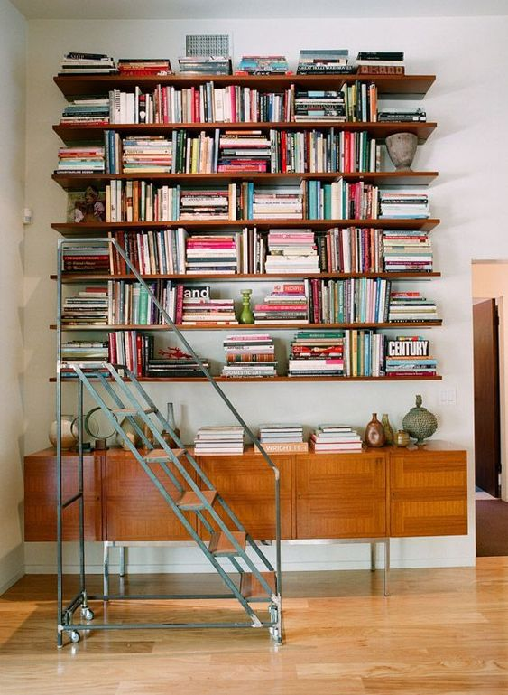 wooden floating shelves, wooden cabinet, white wall, wooden floor, strolling stairs