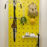 Yellow Pegboard Wall, Shelves, Hooks, Bicycle