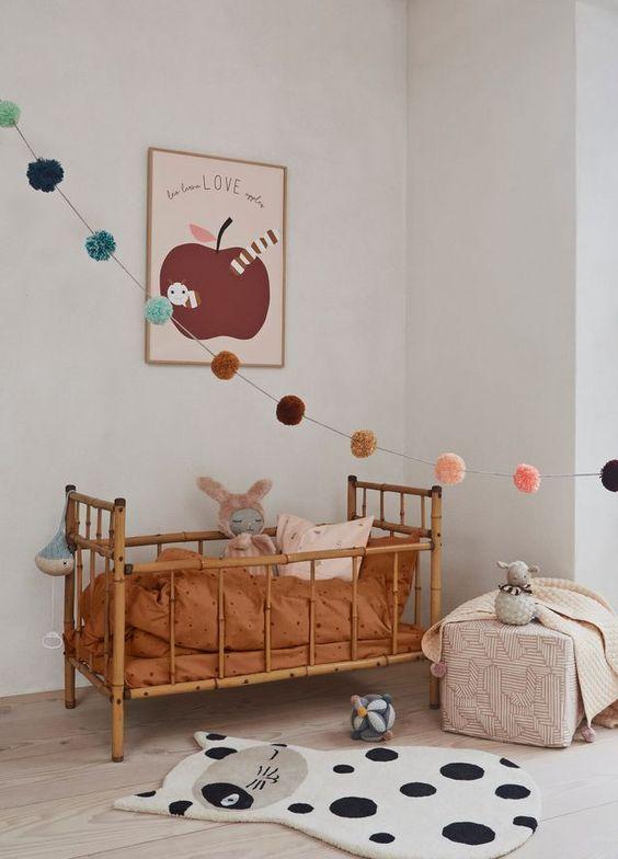 bamboo baby crib, wooden floor, white wall, pink box, cat ru