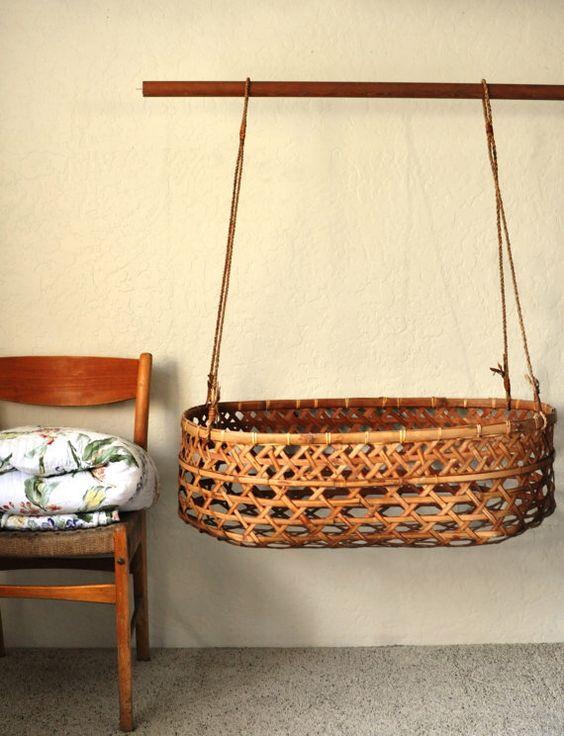 bamboo round baby box swing, grey floor, yellow wall
