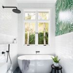 Bathroom, White Subway Wall Tiles, Grey Floor Tiles, White Tub, White Sink, Black Faucet, Green Wallpaper Accent