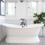 Bathroom, White Wall, White Subway Tiles Wall, Patterned Floor Tiles, White Tub, Globe Framed Pendant