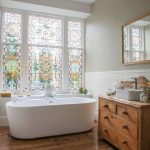 Bathroom, Wooden Floor, White Wainscoting, Grey Wall, White Tub, Tinted Glass, Wooden Cabinet