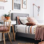 Bedroom, Grey Floor, Grey Bed Platform, White Wall, White Wooden Study Table, Wooden Chair, Pink Pillow, Brown Round Rug