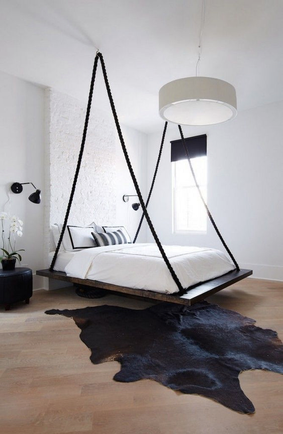 black board floating bed, wooden floor, white wall, white round pendant, white bedding, black sconce