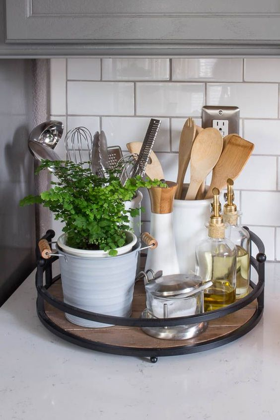 black metal basket with wooden seating for storing kitchen tools