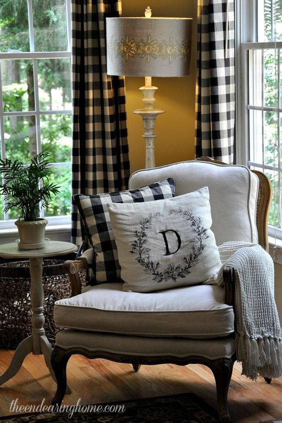 black white curtain and pillow, wooden floor, white chair, white pillow, white side table, yellow wall