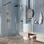 Blue Wall, Blue Pegboard, White Marble Low Vanity, White Round Tall Sink, Black Mirror, Blue Tiles, Shower Area ,chevron Wooden Floor