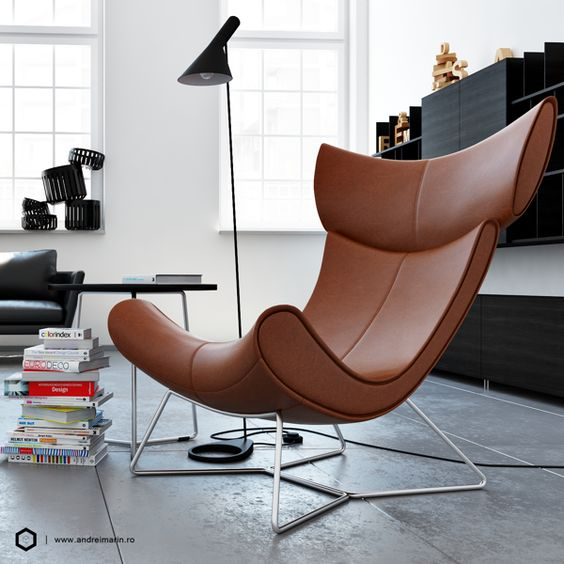 brown leather chair with smooth curvy shape, metal support, grey floor, black cabinet, black floor lamp