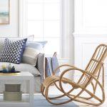 Brown Rattan Chair, Light Wooden Floor, Blue Rug, Grey Sofa, White Wall, Window, Pillows, White Coffee Table