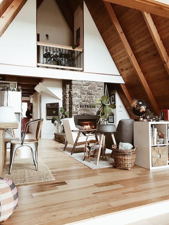 cathedral wooden ceiling, wooden floor, whtie wall, balcony, kitchen, dining set, living room