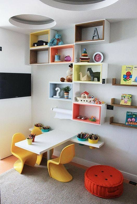 children study room, wooden floor, white wall, colorful box shelves, white floating table, yellow low chairs