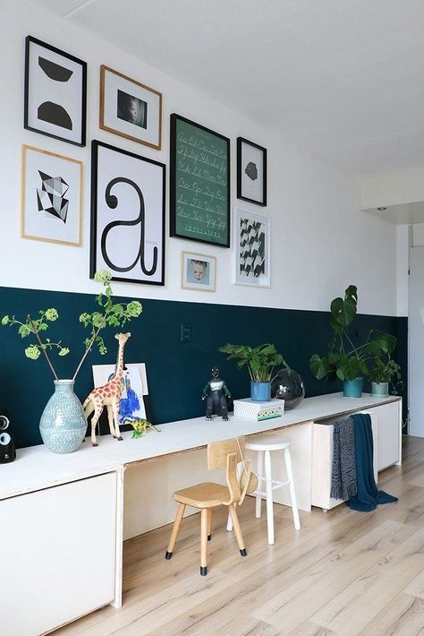 children study, wooden floor, dark green wall, white wall, white storage, white board table, wall decorations