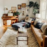 Comfortable Living Room, Wooden Floor, White Wall, White Rug, Brown Leather Sofa, Navy Lounge Chair, Wooden Piano, White Curtain, White Floor Lamp, Rattan Coffee Table