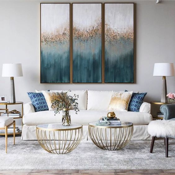 contemporary living rom, marble floor, white wall, white sofa, golden round coffee table, white chair, white stool, golden side shelves with glass top, table lamp