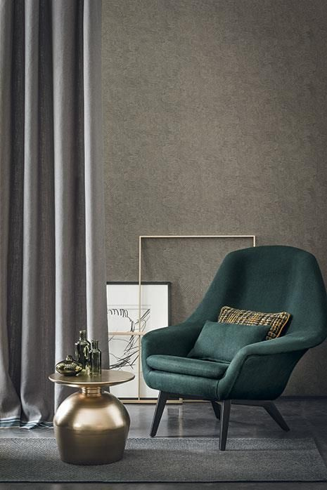 dark green chair with wingback accent, dark grey floor, dark brown wall, golden coffee table