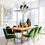Dining Room, Brown Floor, Green Velvet Chairs With Golden Suport, White Wall, Chandelier, Wooden Table