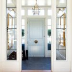 Entrance, White Framed Window And Wall Parition, Chandelier, Light Blue Door, Blue Chevron Floor Tiles, White Ceiling