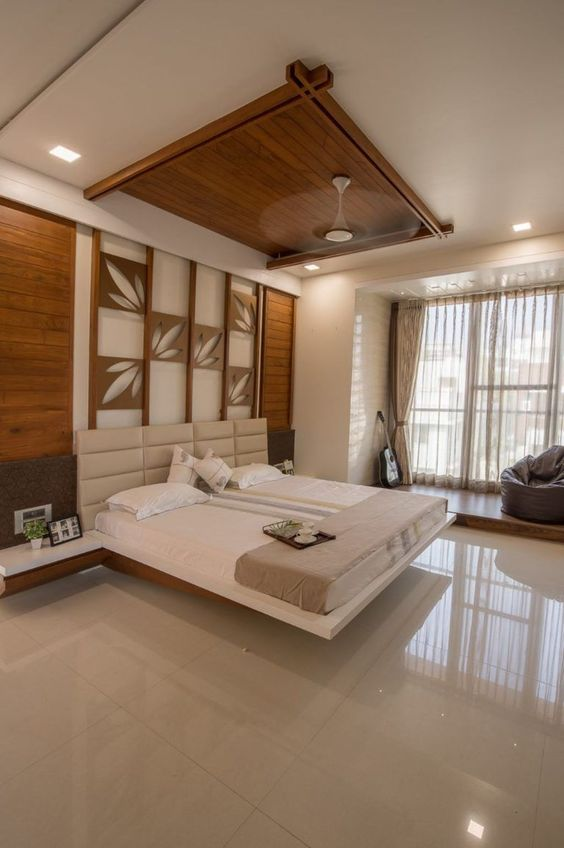 floating bed platform, floating side table, white leather headboard, accent wall, statement ceiling, white floor